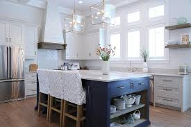 navy blue kitchen island with open shelves