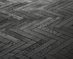 black timber floor herringbone parquet