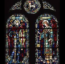 stained glass window with two large arched portions depicting biblical figures and with three smaller elements