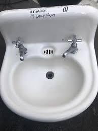vintage antique white cast iron porcelain bathroom sink with faucets 1916 1930