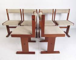 this stylish set of six danish modern dining chairs feature sy teak construction with upholstered seats