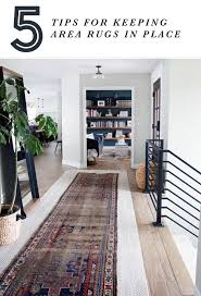 a few months ago we layered a really gorgeous vintage rug from here on top of our flor tiles in our entry while we loved the character it added