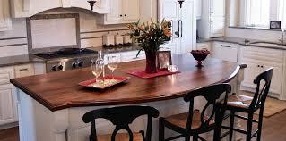 waterlox finish walnut wood island countertop with one scalloped edge