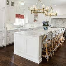 long kitchen island with six counter stools
