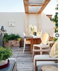 condo outdoor furniture dining table balcony. love this beamed garden feature could be done on a condo balcony outdoor furniture dining table e