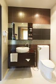 half bathroom ideas brown. elegant design of the half bathroom ideas with white toilets and brown wooden cabinets g