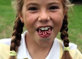 gene simmons son tongue. tongue twister - girl twists her tongue. zungenverdreher. mädchen verdreht und faltet ihre zunge gene simmons son o