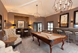 view full size stunning game room with beadboard vaulted ceiling punctuated by restoration hardware foucault s twin orb chandeliers