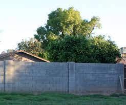 concrete block wall in backyard pic