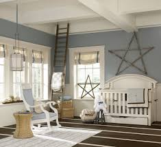 chic nursery rocker in traditional eanf with rustic accents next to empire rocker chair nursery alongside rustic accent wall and baby crib