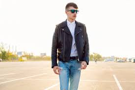man in leather jacket and jeans with sunglasses
