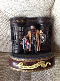 Harry potter water globe featuring the slytherin crest, slytherin scarf and the sorting hat. Harry Potter San Francisco Music Box Company Ollivanders Wand Shop Music Box 1618946188
