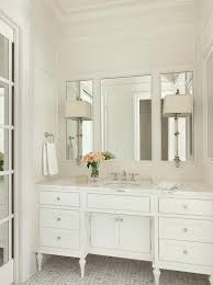 white bathroom vanity mirrors. Brilliant White Elegant White Bathroom Features Walls Accented With Molding And  Illuminated By Two Cawdor Stanchion Wall Lights Mounted To A Framed Vanity  And White Bathroom Vanity Mirrors