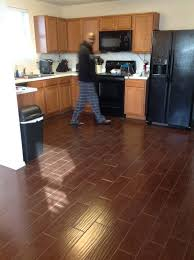 laminate wood flooring vstile or tile in kitchen bathroom floor