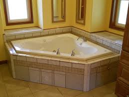 corner bathtub with matching tile shower