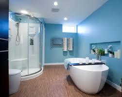 bathroom ideas blue wall paint window ventilation wooden lamiante flooring standalone bathtub glass shower cabin partition