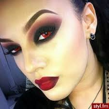 this was the devils makeup as it was subtle enough for her to be disguised as a human but the red represented evil and the fact she had red eyes the