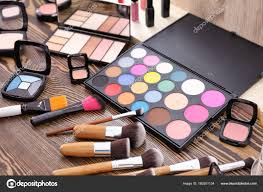 decorative cosmetics and tools of professional makeup artist on dressing table photo by belchonock