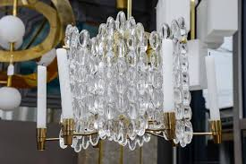 mid century modern brass and crystal chandelier with both electrical and candles light for