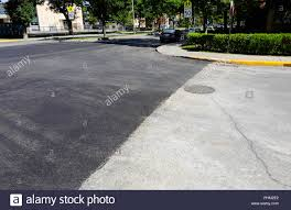 An Avenue Of Newly Laid Asphalt On A Road In Montreal Qc