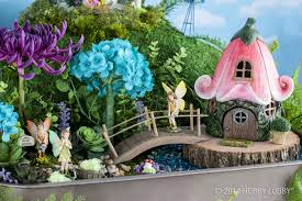 Encourage your child's imagination with a beautiful fairy garden, complete  with miniature fairies and other