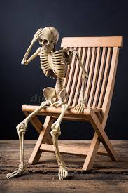 full size of home alluring skeleton sitting in chair 2 headache posture wood 61630010 skeleton sitting