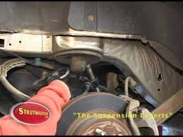 how to fix the rear suspension on a buick lucerne