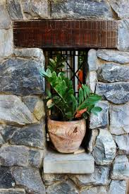 street house window building home pot rustic fl idyllic decoration green cottage backyard exterior residential stone wall lifestyle