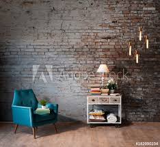 old brick wall background with sofa and