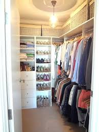 the cove light features create an elegant milieu in this walk closet make a behind bed