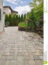 Backyard Rocks Backyard Brick Paver Patio With Pond Royalty Free Stock Image