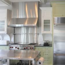 industrial chic farmhouse kitchen inspiration with green cabinets custom stainless island and black stained