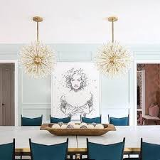brass sputnik chandeliers with marble and brass dining table