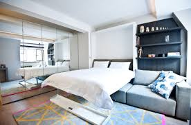 Studio Apartment Bed Studio Apartment With Unfolding Bed And Mirrored Closet Doors