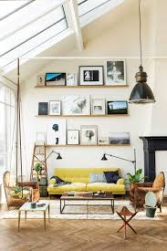high ceiling living room with yellow count and pictures on ledge
