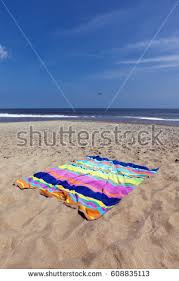beach towel on beach. Interesting Towel Colorful Beach Towel On Sand With Ocean And Sky Background Vertical Throughout Beach Towel On