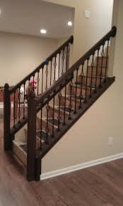 Fascinating Staircase Idea With Black Wrought Iron Baluster And Dark Brown  Oak Wood Handrail - pictures, photos, images NO trim on wall under railing.