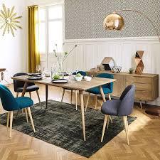 vine dining room copper arc l and teck table salle à dîner vine avec une le arc cuivrée et une table en teck