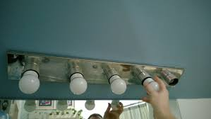 which released the top part of the fixture from the part housing the wiring