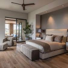 contemporary design bedrooms. Example Of A Large Trendy Master Medium Tone Wood Floor And Brown Bedroom Design In Contemporary Bedrooms R