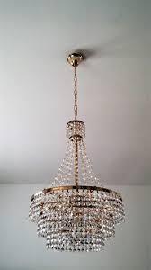 old crystal copper coloured metal chandelier