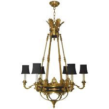 french empire style six arm chandelier in gold dore bronze and black tole accent for
