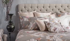 stylised maxi flowers patterns of roses and watercolour fl motifs delicately decorate bed sets dot quilts duvet covers and
