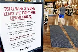 a sign displayed in the entrance to total wine more in ord friday details