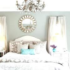 over the bed wall art above the bed wall decor ideas add a sunburst mirror above