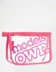 models own small make up bag