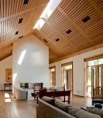 recessed track lighting in the ceiling provides ambient lighting into the room two of these ambient track lighting