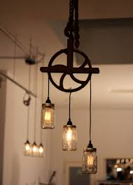 Pulley chandelier with mason jar pendant lights and Edison bulbs Commercial  Projects :Marian Built |