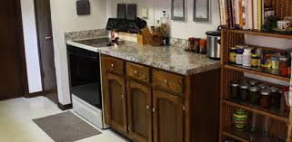 Faux granite kitchen countertop and spruced up cabinets after makeover.