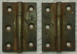 pair of reclaimed cast iron hinges